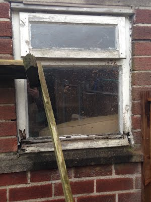 Old window on outhouse was dangerously rotten
